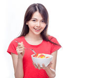 Chinese woman holding bowl of fruit Stock Photos
