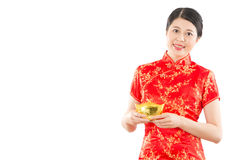 Chinese woman holding golden ingot. Beautiful mixed race asian chinese woman holding golden ingot for new year mean get rich and luck. isolated on white royalty free stock photos