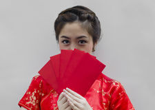 Chinese woman holding red bags Stock Image