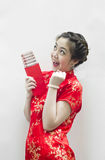 Chinese woman holding red packet Stock Image