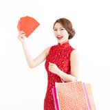Chinese woman holding shopping bags and Red envelopes Stock Images