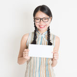 Chinese woman holding white blank paper card Royalty Free Stock Image