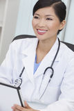 Chinese Woman Hospital Doctor on Tablet Computer Royalty Free Stock Images