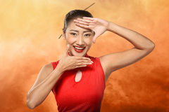 Chinese Woman In Cheongsam Dress Framing Her Face With Hand Stock Image