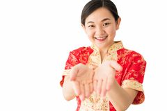 Chinese woman isolated on white in new year. Beauty China girl or woman wear red cheongsam and smile to you in chinese new year 2019 isolated on white background stock images
