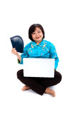 Chinese Woman with laptop, holding hand fan Stock Photos