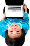 Chinese Woman with laptop smiling,  above view, Royalty Free Stock Photo
