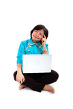 Chinese Woman with laptop, thinking Royalty Free Stock Photography