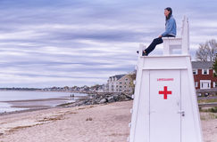 Chinese woman on lifeguard chair Royalty Free Stock Photos