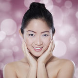 Chinese woman with light glitter background Royalty Free Stock Images
