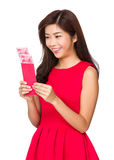 Chinese Woman look at the red pocket money Royalty Free Stock Image