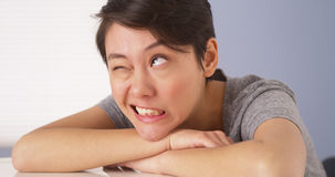 Chinese woman making silly faces at camera Royalty Free Stock Photography