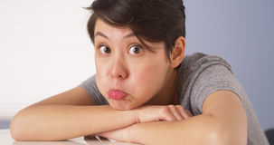 Chinese woman making silly faces at camera. Funny chinese woman making silly faces at camera Stock Image