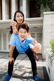 Chinese woman and man enjoying the new home Royalty Free Stock Images