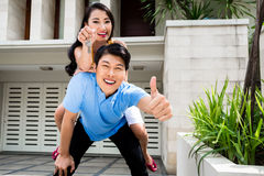 Chinese woman and man enjoying the new home Royalty Free Stock Photography