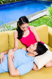 Chinese woman and man of sofa in their home Stock Image