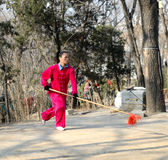 Chinese woman martial artist. Woman martial artist doing exercise  in xigu park Tianjin China photoed on March 9th 2014 Royalty Free Stock Photo