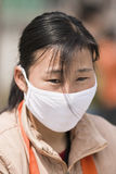 Chinese woman with mouth cap in Beijing, China Stock Photo