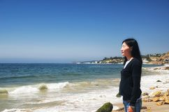 A chinese woman near the PCH in Malibu California royalty free stock photos