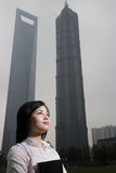 Chinese woman near skyscrapers Royalty Free Stock Photo