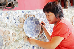 Chinese woman and old porcelain Royalty Free Stock Photos