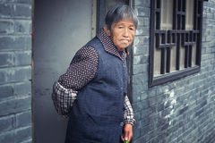 Chinese woman. From old chinese postal village looking along the street Stock Photo