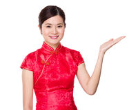 Chinese woman with open hand palm Royalty Free Stock Images
