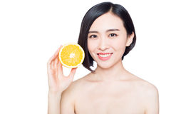 Chinese woman with oranges in her hands Stock Photos
