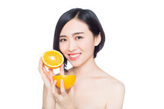 Chinese woman with oranges in her hands Stock Image
