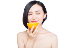 Chinese woman with oranges in her hands Stock Images