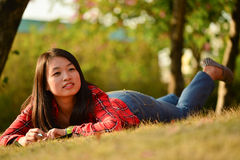 Chinese woman in the park Royalty Free Stock Image