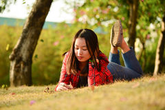 Chinese woman in the park Stock Images