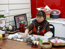 Chinese woman performing the tea ceremony Royalty Free Stock Image