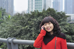 Chinese woman on the phone Royalty Free Stock Photo