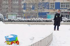 A Chinese woman playing in the snow field Royalty Free Stock Images