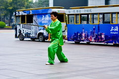 Chinese woman practice Tai Chi in Nanjing Road Shanghai China Royalty Free Stock Image