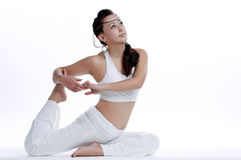 Chinese woman practicing yoga Stock Image