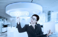 Chinese woman pressing start button Royalty Free Stock Photography