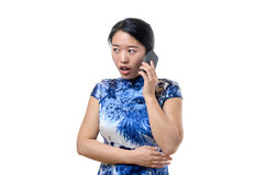 Chinese woman reacting in shock and dismay. Attractive young Chinese woman reacting in shock and dismay standing with her mouth open at news she has just heard stock photo