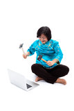 Chinese Woman ready to destroy laptop Royalty Free Stock Image