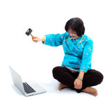 Chinese Woman ready to destroy laptop with hummer Royalty Free Stock Images