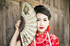 Chinese woman red dress traditional cheongsam Royalty Free Stock Images