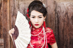 Chinese woman red dress traditional cheongsam Royalty Free Stock Photo