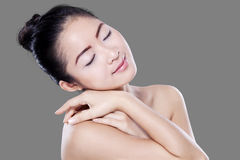 Chinese woman relaxing after skincare Royalty Free Stock Images
