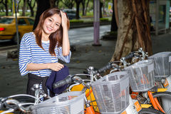 Chinese woman by rental bikes in Taipei City stock photo