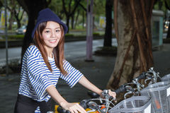 Chinese woman by rental bikes royalty free stock photos