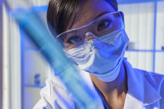 Chinese Woman Scientist With Test Tube in Laboratory Royalty Free Stock Images
