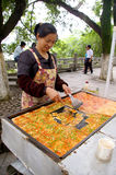 Chinese woman selling tofu on street Stock Photo