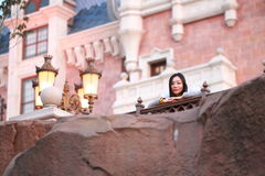 A Chinese woman in Shanghai Disney land Stock Photos