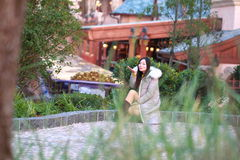 A Chinese woman in Shanghai Disney land Royalty Free Stock Photography